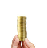 Gold coins in a hand Royalty Free Stock Images