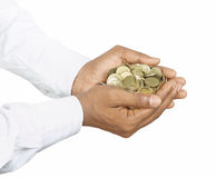 Gold Coins in Hands Stock Photos