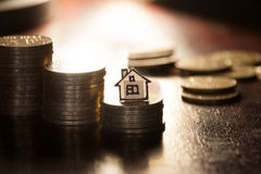 Gold coins and house. Real estate loan concept, money for home, gold coins and house royalty free stock photo