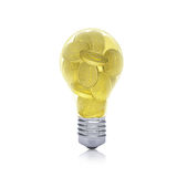Gold coins inside bulb Stock Image