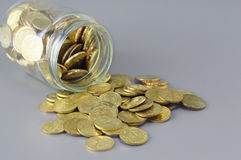 Gold Coins and Jar - Business Concept Royalty Free Stock Photo