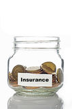 Gold coins in jar with Insurance Stock Photos
