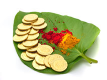 Gold coins kept on betel leaf Stock Photo