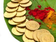 Gold coins kept on betel leaf Stock Images
