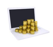 Gold coins on the laptop Stock Image