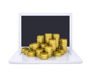Gold coins on the laptop Stock Photos