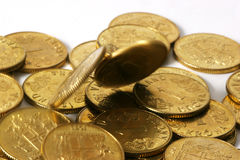 Gold coins in motion Royalty Free Stock Images