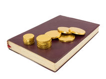 Gold coins on note book Stock Images