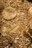Gold in coins, nuggets and ingots Stock Images