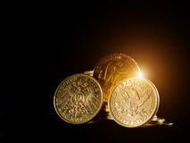 Gold coins over black background Stock Photo
