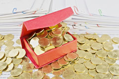 Gold coins overload from red box Royalty Free Stock Photos