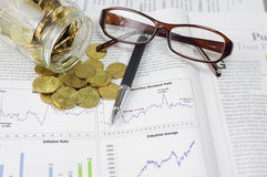 Gold Coins, Pen and Glasses - Business Concept Stock Image