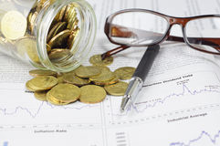 Gold Coins, Pen and Glasses - Business Concept Royalty Free Stock Photography