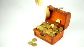 Gold coins and a wooden chest. Gold coins piled in an wooden chest stock video