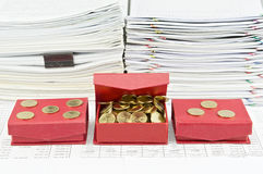 Gold coins and red box arrange on finance account Royalty Free Stock Photography
