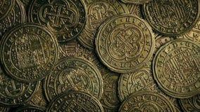 Gold Coins Rotating Macro Shot. Closeup of ancient gold coins rotating stock video footage