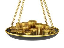 Gold coins on the scales. Stock Photography