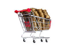 Gold coins in shopping cart Royalty Free Stock Photography