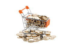 Gold coins in shopping cart Royalty Free Stock Photo