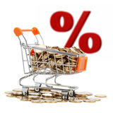 Gold coins in shopping cart with sign of sale on background Stock Images