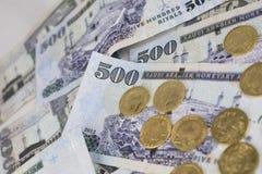 Gold coins sprinkled on five hundred riyal Stock Photos