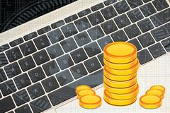 Gold Coins Stack on laptop keyboard earning concept Royalty Free Stock Photography