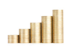 Gold coins stand vertically in columns ascending Stock Image
