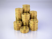 Gold coins in towers. On gray backgroud Royalty Free Stock Photos