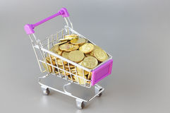 Gold Coins and Trolley - Business Concept Royalty Free Stock Image