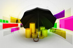 Gold coins under a black umbrella Stock Photo