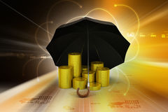 Gold coins under a black umbrella Royalty Free Stock Images