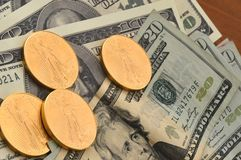 Gold Coins and US Currency Royalty Free Stock Photography