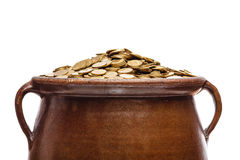 Gold coins in the vintage pot Royalty Free Stock Images
