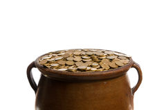 Gold coins in the vintage pot Stock Photos