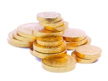 Gold coins. On white background royalty free stock photography