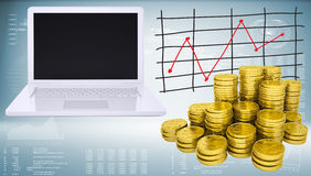 Gold coins and white laptop Stock Images