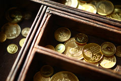Gold coins in wooden casket Stock Photo