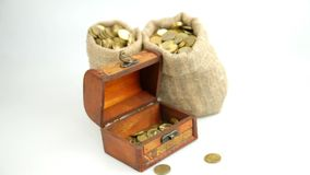 Gold coins in an wooden chest. Gold coins piled in an wooden chest stock video footage