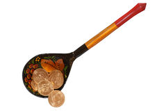 Gold coins in the wooden spoon Stock Images
