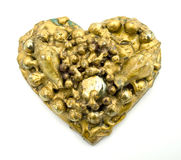 Gold collage heart. With pearls and shells stock photo
