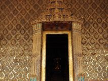 Gold color of asia architecture with buddha statue with motion blur of background Royalty Free Stock Photo
