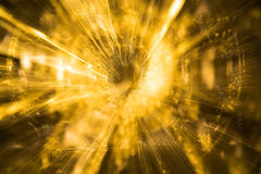 Gold color background. Golden light swirls in a bright abstract background Stock Images