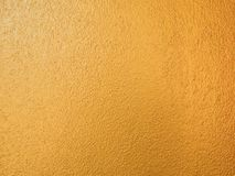 Gold color background. Rough gold texture design on the wall stock photos