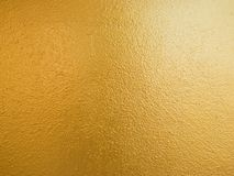 Gold color background. Rough gold texture design on the wall stock images