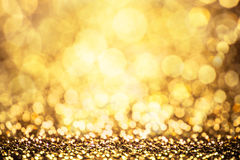 Gold color bokeh glitter background Royalty Free Stock Photos