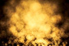 Gold color bokeh glitter background Stock Photo