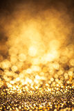 Gold color bokeh glitter background Royalty Free Stock Images
