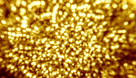 Gold color bokeh of steel. Wool for dish washing Stock Images