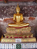 Gold color Buddha statue in Buddhist temple royalty free stock photo