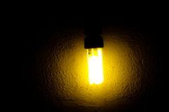 Gold color lamplight. Gold colorful lamp light in night with wall on background Royalty Free Stock Photos